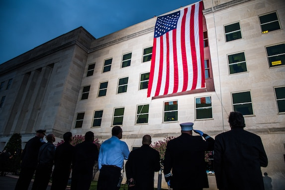 A Pentagon crew unfurls an American flag at dawn at the Pentagon, on the 18th anniversary of the 9/11 attacks, Washington, D.C., Sept. 11, 2019. (DoD photo by U.S. Army Staff Sgt. Nicole Mejia)