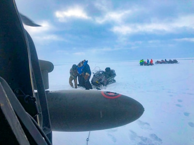 An Alaska Army National Guard UH-60 Black Hawk helicopter aircrew performed a search and rescue mission for three Iditarod mushers about 25 miles east of Nome, March 20, 2020. The mushers and their dogs went through Bering Sea flood waters on the race trail and were wet and freezing. The aircrew transported two firefighter emergency medical technicians and Iditarod dog handlers to assist. The mushers were flown to Nome and transported to a local hospital. A local search and rescue team helped race dog handlers care for the sled team and returned them to Nome. (Courtesy photo)