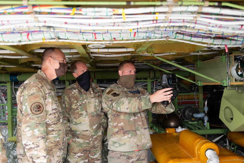 From right, Tech. Sgt. Josef Notter, 157th Maintenance Group, New Hampshire Air National Guard, demonstrates using a thermal camera to inspect KC-46 systems as part of routine maintenance to Brig. Gen. Russell Ponder, National Guard Bureau director of logistics and installations and Brig. Gen. Richard Gibbs, Headquarters Air Mobility Command director of logistics, engineering and force protection, during a KC-46 tour, Sept. 9, 2020, at the Manchester-Boston Regional Airport, Manchester, New Hampshire. The wing is temporarily operating it's KC-46 refueling mission out of the civilian airport while the runway at the Pease International Airport in Newington is renovated from Sept. 8-22. (Air National Guard photo by Tech. Sgt. Aaron Vezeau)
