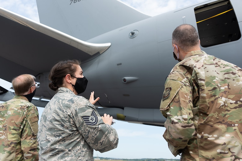 Tech. Sgt. Ashley LaValley, an avionics technician with the 157th Maintenance Group, New Hampshire Air National Guard, briefs Brig. Gen. Russell L. Ponder, National Guard Bureau director of logistics and installations and Brig. Gen. Richard W. Gibbs, Headquarters Air Mobility Command director of logistics, engineering and force protection, on KC-46 avionics systems maintenance procedures, Sept. 9, 2020, at the Manchester-Boston Regional Airport, N.H. The Wing is temporarily operating it's KC-46 air refueling mission out of the civilian airport while the runway at the Pease International Airport undergoes renovations from Sept. 8-22. (Air National Guard photo by Tech. Sgt. Aaron Vezeau)
