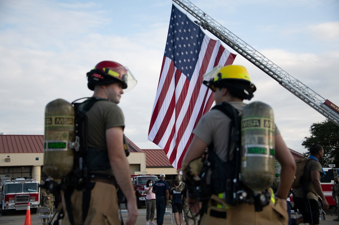 Firefighters from the 42nd Air Base Wing attend a 9/11 remembrance ceremony, Sept. 11, 2020, on Maxwell Air Force Base, Alabama. Prior to the ceremony, members from the Maxwell-Gunter community participated in a 2.72 mile ruck march. (U.S. Air Force photo by Airman 1st Class Jackson Manske)