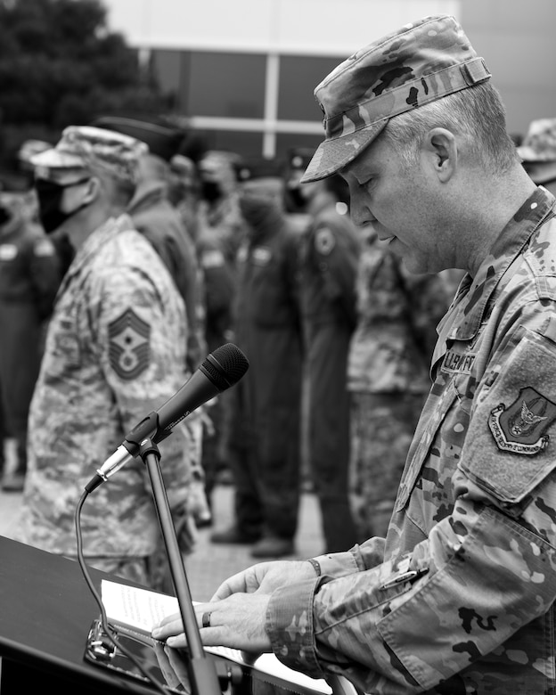 Maj. Scott Allen, the 910th Airlift Wing chief of public affairs, reads off the events of 9/11, Sept. 11, 2020, during Youngstown Air Reserve Station's 9/11 remembrance ceremony. The installation has held a ceremony every year to honor those who lost their lives in the terrorist attacks at Sept. 11, 2001.