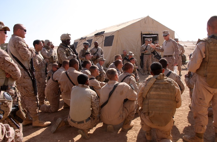 U.S. Marine Colonel D. W. Elzie, Commanding Officer of Marine Wing Support Group 37, speaks to Marines from Marine Wing Support Squadron 273 at Sahl Sinjar Air Field in Ninawa province, Iraq, Nov. 2.