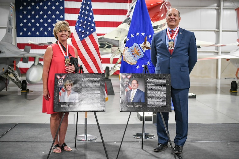 Linda Kelley and Gary Harter were awarded the Hill Air Force Base Community Wingman Award Sept. 10, 2020. The annual honor recognizes community members who have made a significant service contribution to the installation. (U.S. Air Force photo by Cynthia Griggs)