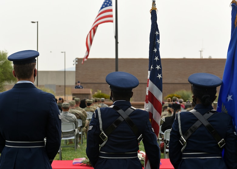 photo of three Air Force Honor Guard members watching a  9/11 remembrance ceremony at Davis-Monthan Air Force Base, Arizona