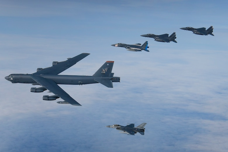 A U.S. Air Force B-52H Stratofortress leads a formation of U.S. F-15C Eagles, F-15E Strike Eagles and Royal Netherlands Air Force F-16's over the North Sea during exercise Point Blank 20-04. Point Blank is a recurring, low-cost exercise initiative designed to increase tactical proficiency of U.S., Ministry of Defence, and other NATO forces. (U.S. Air Force photo/ Master Sgt. Matthew Plew)