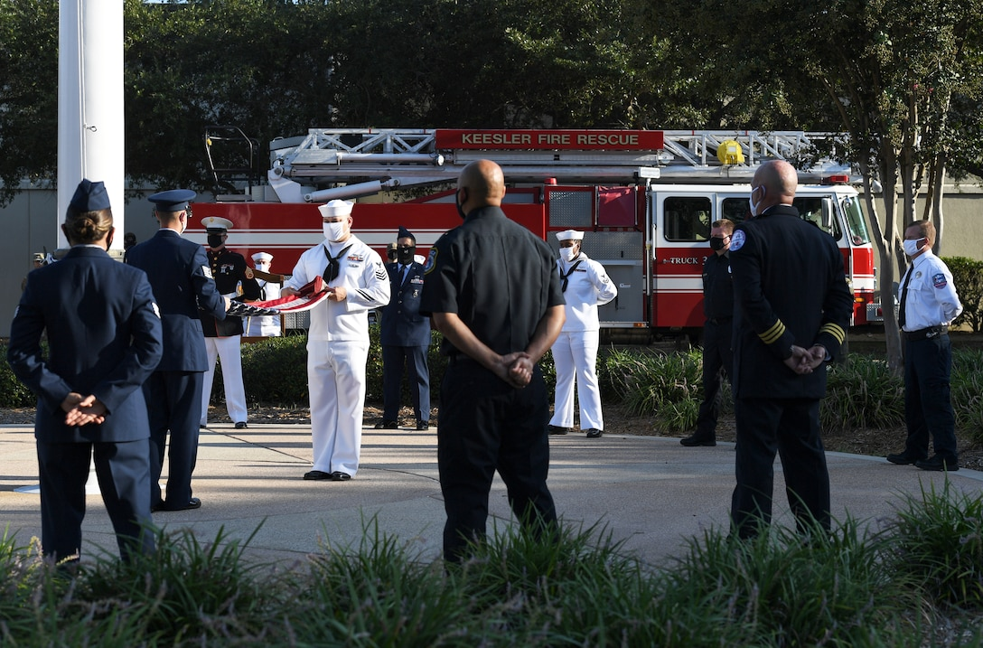 Keesler Airmen, Sailors and Marines participate in a 9/11 memorial ceremony hosted by the Center for Naval Aviation Technical Training Unit Keesler in front of the 81st Training Wing headquarters building at Keesler Air Force Base, Mississippi, Sept. 11, 2020. The event honored those who lost their lives during the 9/11 attacks. (U.S. Air Force photo by Kemberly Groue)
