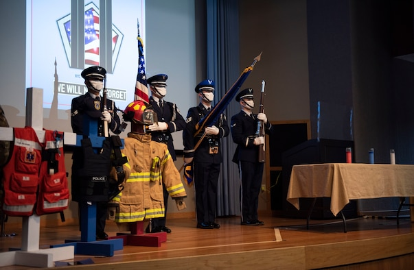 The 47th Flying Training Wing Honor Guard presents the U.S. and Air Force flags for the 9/11 Remembrance Ceremony on Sept. 11, 2020 at Laughlin Air Force Base, Texas. Their performance helped those present and those watching the livestream recognize all who gave their lives that day.
