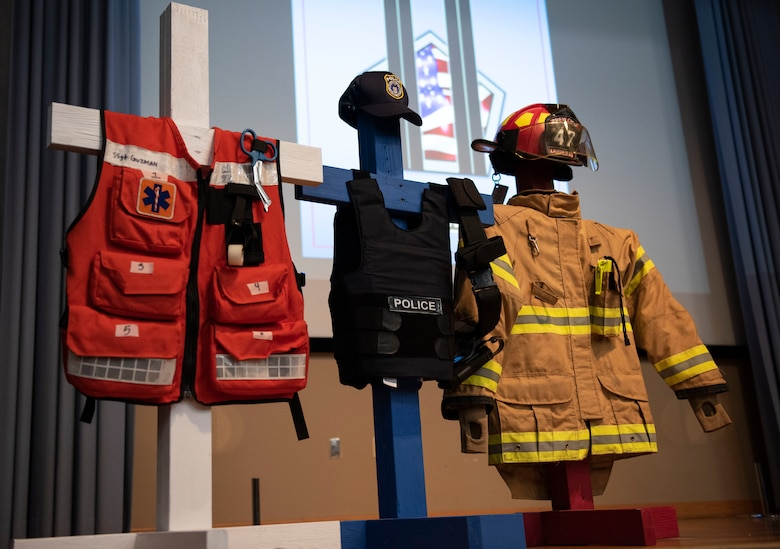 A display for Team XL's 9/11 Remembrance Ceremony on Sept. 11, 2020 at Laughlin Air Force Base, Texas, represents the first responders who answered the call and gave their life during the terrorist attacks of 2001. The display shows uniforms of an emergency medical technician, a policeman and a fireman. (U.S. Air Force photo by Airman 1st Class David Phaff)