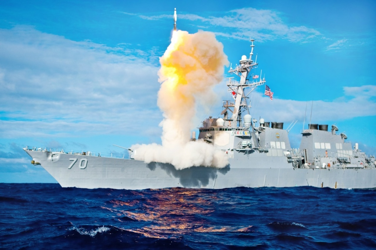 A ship deploys a missile.