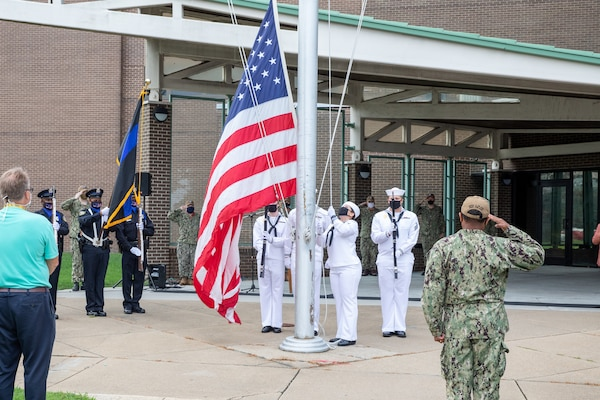 Norfolk Naval Shipyard Sailors hoist the flag for the Patriot Day Remembrance Ceremony in honor of those who have fallen.