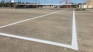Newly painted tennis court with a new net at Minot Air Force Base North Dakota.  5th Civil Engineering Squadron contracted a new painting of the lines and replaced the tennis nets in August, 2020. (U.S. Air Force photo by Staff Sgt. Steven Adkins)