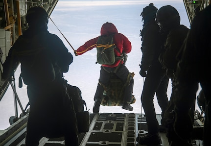 Members of the 212th Rescue Squadron, pararescuemen, combat rescue officers, and Survival, Evasion, Resistance and Escape specialists jump out of a HC-130J Combat King II assigned to the 211th Rescue Squadron in response to a simulated alert rescue call at Deadhorse, Alaska, in support of exercise Arctic Eagle 2020, Feb. 25, 2020. The Alaska National Guard is hosting exercise Arctic Eagle 2020, a joint-training exercise, Feb. 20 to March 6, 2020 throughout Alaska, including Joint Base Elmendorf-Richardson, Eielson Air Force Base, Fort Wainwright, the Yukon-Kuskokwim Delta and as far north as Teshekpuk Lake. As a homeland security and emergency response exercise, Arctic Eagle 20 is designed to increase the National Guard's ability and effectiveness to operate in the extreme cold-weather conditions found in Arctic environments. (U.S. Air Force photo by Senior Airman Xavier Navarro)