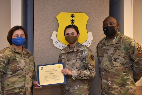 U.S. Air Force Col. Angelina Maguinness, 17th Training Group commander, and Chief Master Sgt. Charmane Tatum, 17th TRG superintendent, present 2nd Lt. Kristen Ketterer, 315th Training Squadron student, with her award. The 315th TRS' vision is to develop combat-ready intelligence, surveillance and reconnaissance professionals and promote an innovative squadron culture and identity unmatched across the U.S. Air Force. (U.S. Air Force photo by Staff Sgt. Seraiah Wolf)
