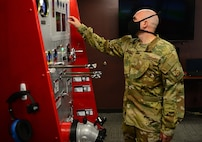 U.S. Air Force Tech. Sgt. Scott Ruester, the 354th Fire Emergency Services assistant chief of operations, demonstrates a fire engine simulator at the main fire station on Eielson Air Force Base, Alaska, Sept. 11, 2020. The mission of the Eielson Fire Department is to provide fire emergency services for the preservation of life, property and the mission of Eielson AFB. (U.S. Air Force photo by Staff Sgt. Sean Martin)