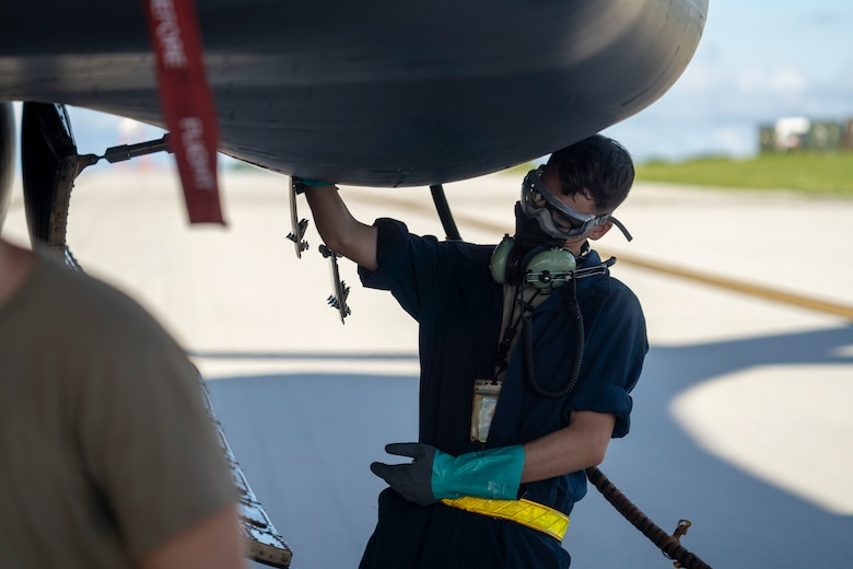 A maintainer assigned to the 34th Expeditionary Bomb Squadron conducts post-flight maintenance after a B-1B Lancer arrives at Andersen AFB, Guam, Sept. 10, 2020. Approximately 200 Airmen and four B-1s assigned to the 28th Bomb Wing at Ellsworth AFB, South Dakota, deployed to the Pacific in support of the Bomber Task Force employment model. The BTF is deployed to Andersen AFB to support Pacific Air Forces' training efforts with allies, partners and joint forces; and strategic deterrence missions to reinforce the rules-based order in the Indo-Pacific region. (U.S. Air Force photo by 1st Lt. Joshua Sinclair)