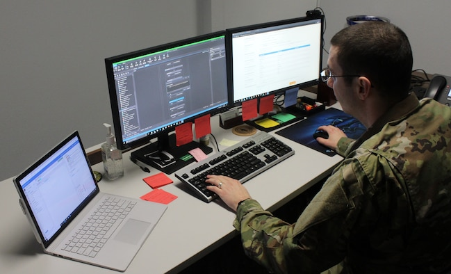 """Tech. Sgt. Matthew Goff, NCOIC of Administration at OSI Det. 813, Minot Air Force Base, N.D., works the computer generated program designed to teach his robot/Artificial Intelligence (AI) to follow a set of programed actions to complete a specified task. As the user/developer, Sergeant Goff has to """"teach"""" each step of the process, and what to do if the robot/AI encounters an error. (Photo by SA Eric Little/OSI Det. 813)"""