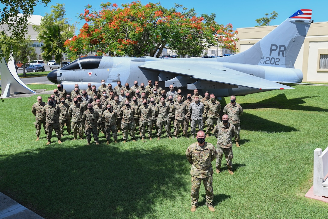 Members of the 132d Wing pose for a group photo at the completion of their TDY to the 156th Wing in San Juan, Puerto Rico. The team spent two weeks helping PRANG with their re-mission. (Puerto Rico Air National Guard photo by Master Sgt. Caycee Watson)