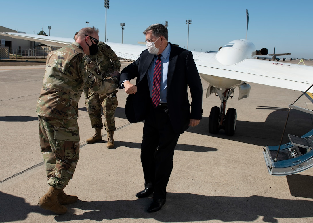 U.S. Air Force Col. John Creel, 39th Air Base Wing commander, greets U.S. Ambassador to Turkey David Satterfield with an elbow bump on the base's flightline.