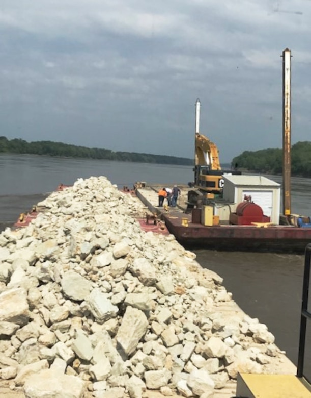 U.S. Army Corps of Engineers, Kansas City District's floating plant places rock on a Missouri River training structure near river mile 105 (Gasconade Bend).