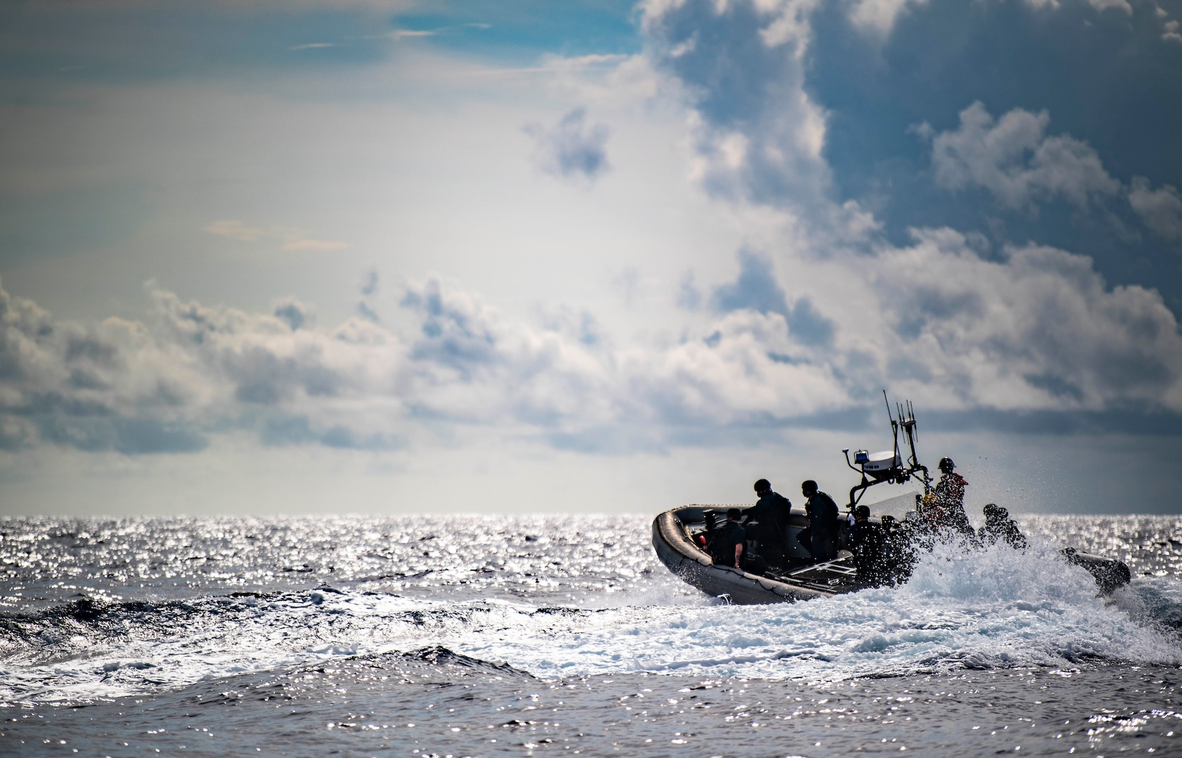 Sailors conduct visit, board, search, and seizure exercise in rigid-hull inflatable boat
