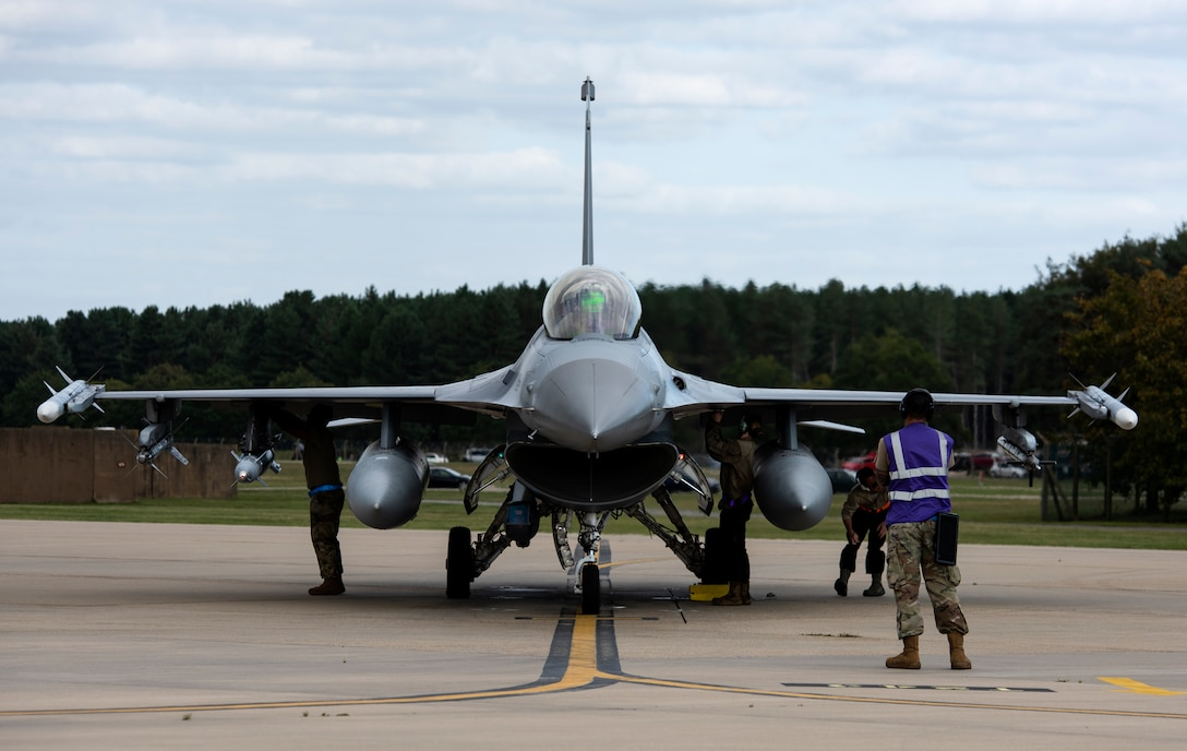 Maintenance crew, assigned to the 31st Fighter Wing, Aviano Air Base, Italy, perform pre-flight checks on an F-16 Fighting Falcon at Royal Air Force Lakenheath, England, Sept. 10, 2020. The 510th FS is conducting close air support training with the 321st Special Tactics Squadron, the 19th Regiment Royal Artillery and the 2nd Air Support Operations Squadron to improve combat capabilities and interoperability between allied nations. (U.S. Air Force photo by Airman 1st Class Jessi Monte)