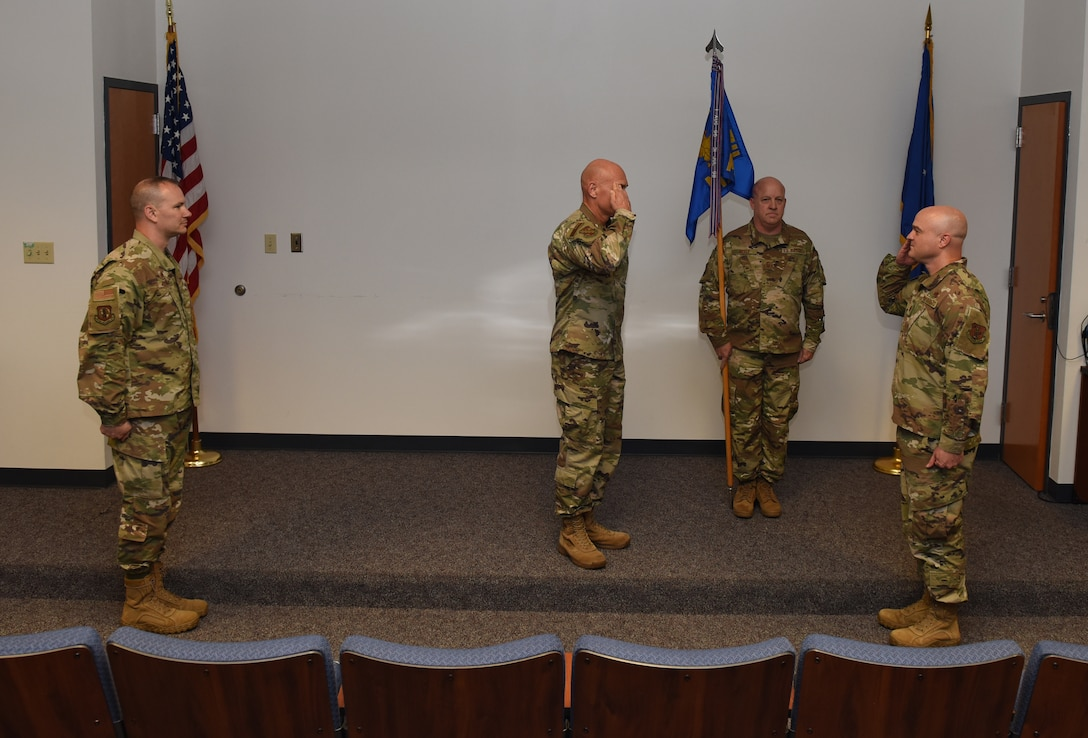 Photo of Major Reed saluting Colonel Hendrix as he accepts command of the 126th Maintenance Squadron.