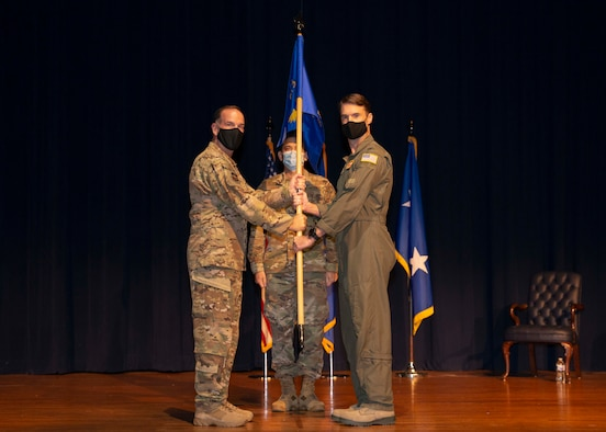 Maj. Gen. John P. Healy, 22nd Air Force commander, presents the guidon to Col. Christopher K. Lacouture, 913th Airlift Group commander, during an assumption of command ceremony at Little Rock Air Force Base, Ark, Sept. 12, 2020. The 913th AG is comprised of almost 400 personnel, 80 percent of which are part-time members balancing both civilian and military careers. (U.S. Air Force Reserve photo by Senior Airman Chase Cannon)