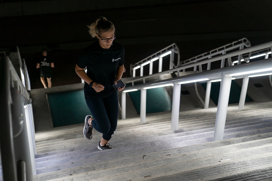 A U.S. Marine runs up a flight of stairs during stair walk at the San Diego Convention Center, San Diego, Sept. 11.