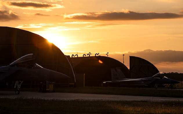 Two F-15C Eagles, assigned to the 493rd Fighter Squadron, are parked on the flightline prior to evening take-offs at Royal Air Force Lakenheath, England, Sept. 8, 2020. Night Flying Exercises provide 48th Fighter Wing aircrew and support personnel the experience needed to maintain a ready force capable of ensuring the collective defence of the NATO alliance. (U.S. Air Force photo by Airman 1st Class Jessi Monte)