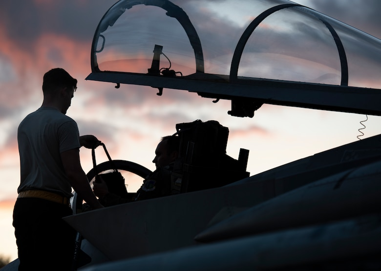 A U.S Air Force 748th Aircraft Maintenance Squadron crew chief and a pilot assigned to the 493rd Fighter Squadron prepare to launch at Royal Air Force Lakenheath, England, Sept. 8, 2020. Night Flying Exercises provide 48th Fighter Wing aircrew and support personnel the experience needed to maintain a ready force capable of ensuring the collective defence of the NATO alliance. (U.S. Air Force photo by Airman 1st Class Jessi Monte)