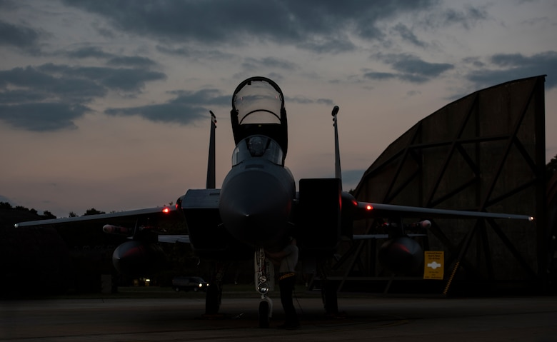 A U.S. Air Force F-15C Eagle assigned to the 493rd Fighter Squadron awaits completion of pre-flight checks at Royal Air Force Lakenheath, England, Sept. 8, 2020. Night Flying Exercises provide 48th Fighter Wing aircrew and support personnel the experience needed to maintain a ready force capable of ensuring the collective defence of the NATO alliance. (U.S. Air Force photo by Airman 1st Class Jessi Monte)