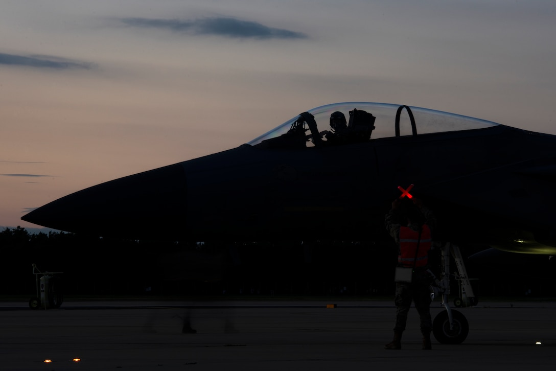 A U.S. Air Force F-15C Eagle, assigned to the 493rd Fighter Squadron, awaits completion of pre-flight checks at Royal Air Force Lakenheath, England, Sept. 8, 2020. Night Flying Exercises provide 48th Fighter Wing aircrew and support personnel the experience needed to maintain a ready force capable of ensuring the collective defence of the NATO alliance. (U.S. Air Force photo by Airman 1st Class Jessi Monte)