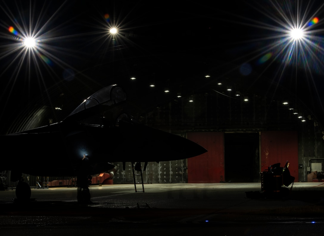 A U.S. Air Force crew chief, assigned to the 748th Aircraft Maintenance Squadron, performs routine post-flight maintenance on an F-15C Eagle at Royal Air Force Lakenheath, England, Sept. 8, 2020. Night Flying Exercises provide 48th Fighter Wing aircrew and support personnel the experience needed to maintain a ready force capable of ensuring the collective defence of the NATO alliance. (U.S. Air Force photo by Airman 1st Class Jessi Monte)