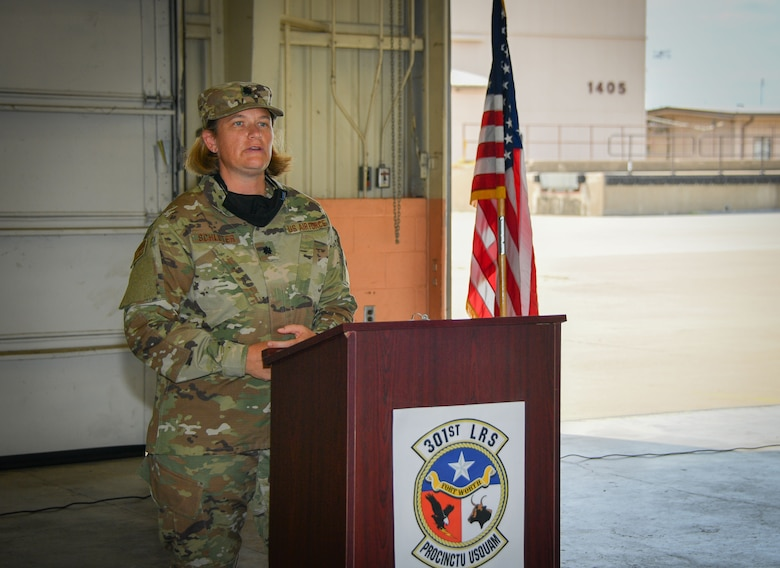 Lt. Col. Farrah Schluter, 301st Fighter Wing Logistics Readiness Squadron commander, addresses her Airmen during the 301st FW LRS assumption of command ceremony, September 13, 2020, at U.S. Naval Air Station Joint Reserve Base Fort Worth, Texas. She is responsible for 127 Traditional Reservists, Air Reserve Technicians, Active Guard Reserves, and civilian personnel. She is responsible for logistics plans, vehicle operations, vehicle maintenance, fuels, supply, and traffic management. (U.S. Air Force photo by Staff Sgt. Randall Moose)