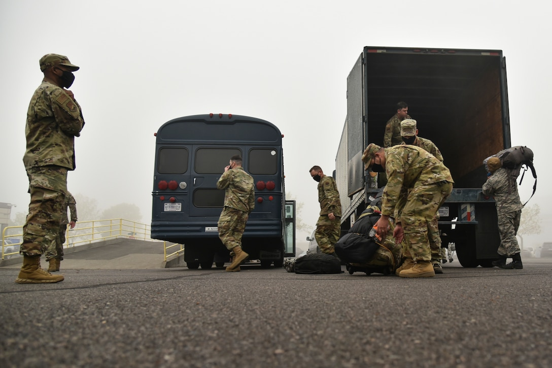 Oregon Air National Guard members from the 142nd Wing load their gear in a truck before leaving from the Portland Air National Guard Base, Portland, Ore., Sept. 13, 2020, to support Operation Plan Smokey. OPLAN Smokey is an interagency agreement between the Oregon Military Department and the Oregon Department of Forestry which tasks military members to assist with wildfire management. (U.S. Air National Guard photo by Senior Airman Valerie R. Seelye)