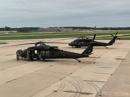 Two UH-60 Black Hawk helicopters from the Wisconsin Army National Guard's 1st Battalion, 147th Aviation, departed for California to battle wildfires Sept. 11, 2020, from Army Aviation Support Facility 2 in Madison, Wis. Two aircraft and approximately 15 Soldiers deployed to California in response to an Emergency Management Assistance Compact request for assistance from California.