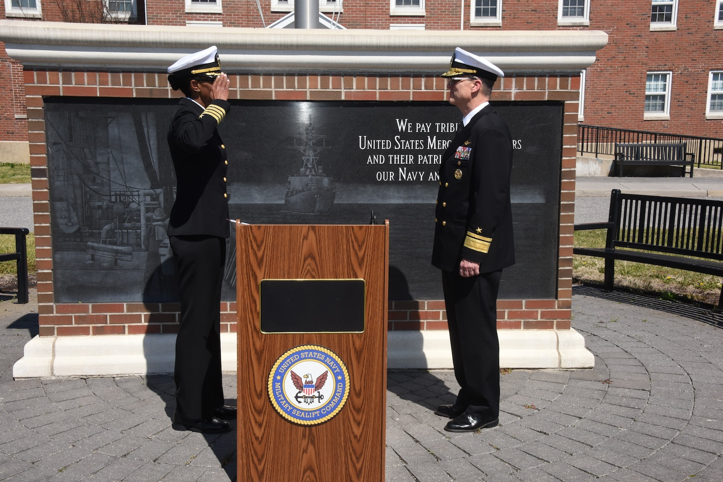 Navy Capt. Janice G. Smith salutes Rear Adm. Michael A. Wettlaufer, commander, Military Sealift Command, after she took command from Navy Capt. Hans E. Lynch as commander of Norfolk-based Military Sealift Command Atlantic during a change of command ceremony held at Naval Station Norfolk outside of MSC headquarters, March 19, 2020.