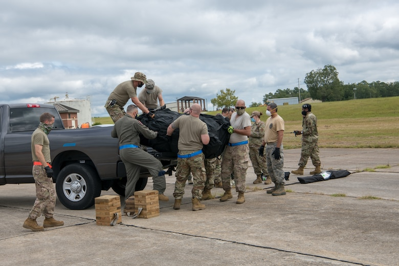 Reservists from the 315th Airlift Wing, Joint Base Charleston, S.C., unload a tent during a readiness exercise September 10, 2020 here. The exercise is in preparation for future missions and helps airmen perform their duties in a live setting.