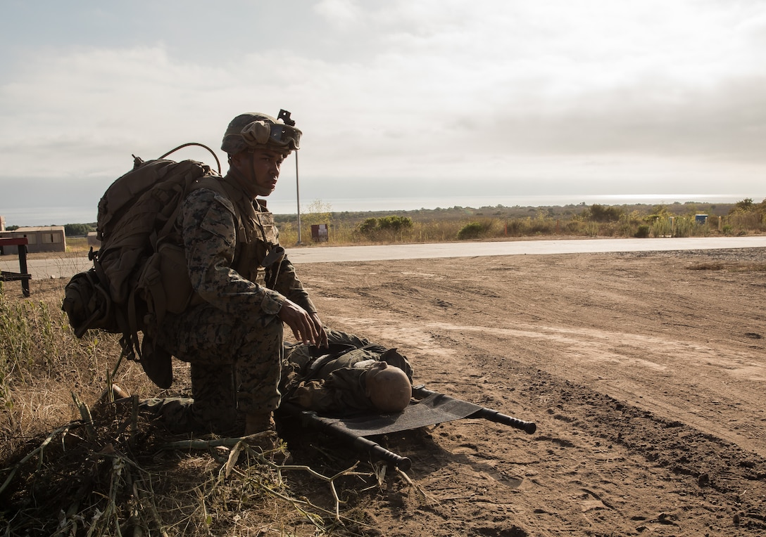 A U.S. Marine provides first aid to a notionally downed pilot during a Tactical Recovery of Aircraft and Personnel Certification on Marine Corps Base Camp Pendleton, Calif., Aug. 4.