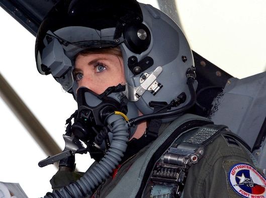 """Capt. Michelle """"Mace"""" Curran, 355th Fighter Squadron F-16 pilot, looks up during launch preparations on the flightline, March 4, 2017. Curran was the first woman assigned to fly in the squadron and attributed her success to her parents, leadership and strong women in aviation past and present who've helped pave the way. (U.S. Air Force photo by Staff Sgt. Samantha Mathison)"""
