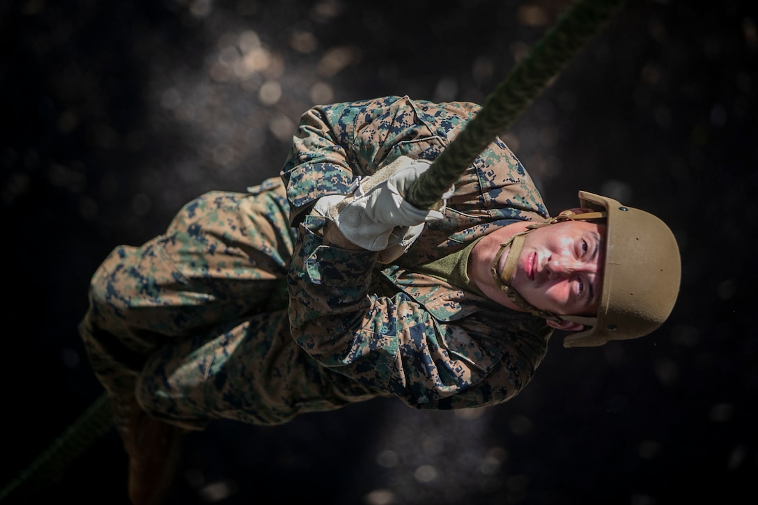 A U.S. Marine conducts a fast roping exercise at the Lightning Academy, East Range Training Complex, Hawaii, Aug. 11.