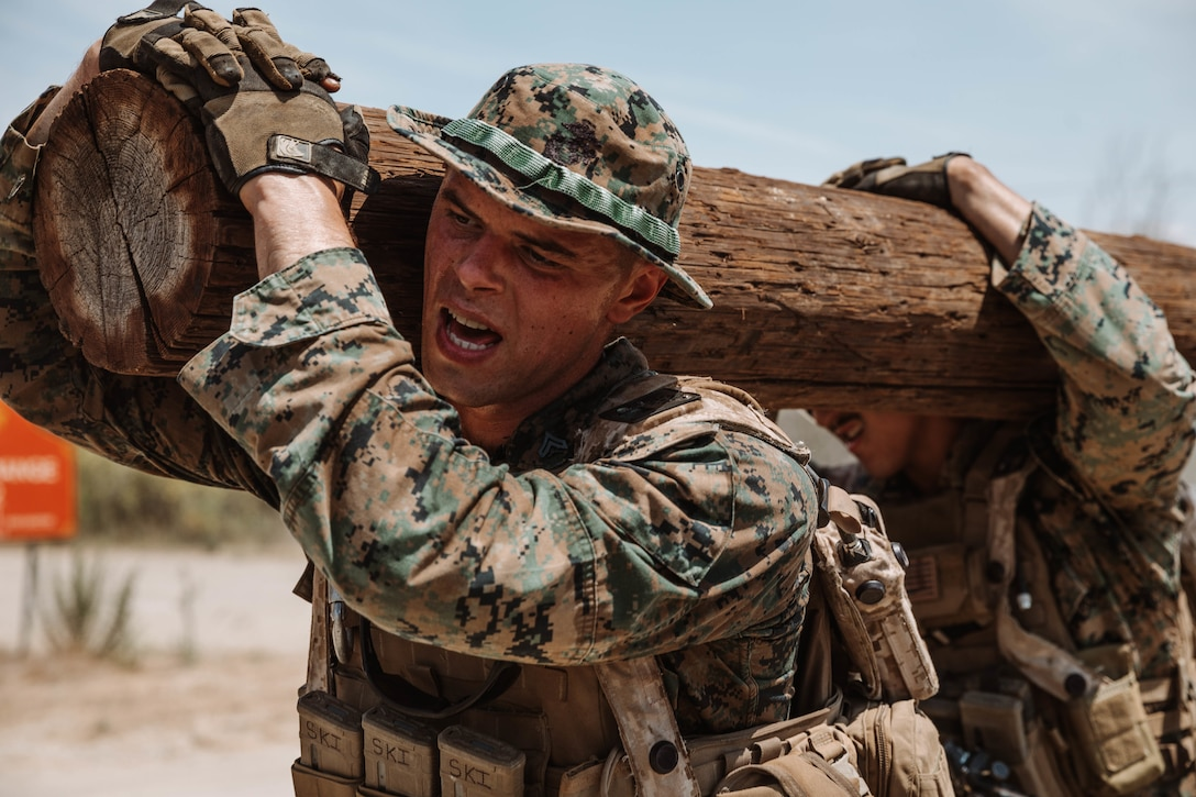 U.S. Marines carry a log as part of the six mile log run during the Supersquad Competition at Marine Corps Base Camp Pendleton, Calif., Aug. 16.