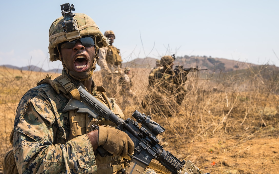 A U.S. Marine relays commands to his fire team while conducting offensive operations during the Supersquad 2020 Competition at Marine Corps Base Camp Pendleton, Calif., Aug. 20.