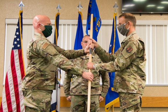 Col. Bill Annie relinquishes command of the 167th Force Support Squadron to Maj. Ben Mathias during a change of command ceremony at the 167th Airlift Wing, Sept. 12, 2020. Annie is now the 167th Mission Support Group commander. Mathias is a pilot for the 167th Airlift Wing, and previously served in the Inspector General's office.