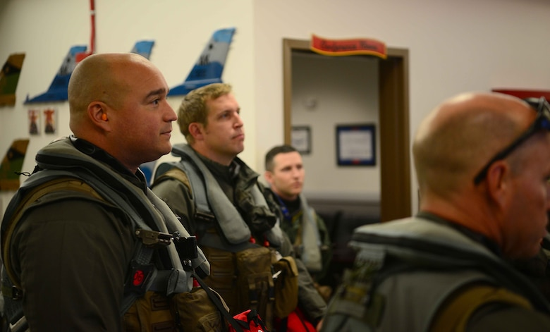 U.S. Air Force F-16 Fighting Falcon pilots, assigned to the 18th Aggressor Squadron, receive a pre-flight brief before departing to support exercise Valiant Shield on Eielson Air Force Base (AFB), Alaska, Sept. 8, 2020. The 18th AGRS will be participating in exercise Valiant Shield from Sept. 8-20 at Anderson AFB, Guam. Valiant Shield 20 provides an effective, flexible and capabilities centered force, enabling real-world proficiency in response to a variety of crises. (U.S. Air Force photo by Staff Sgt. Sean Martin)