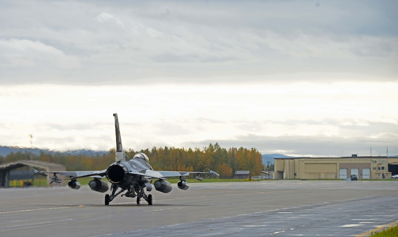 F-16 Fighting Falcons, assigned to the 18th Aggressor Squadron, taxi down the runway on Eielson Air Force Base, Alaska, Sept. 8, 2020. The 18th AGRS pilots are experts in near-peer adversary tactics, techniques and procedures, and use their knowledge to provide realistic training for U.S. and international pilots. Valiant Shield 20 provides an optimal training environment to increase readiness and joint interoperability. (U.S. Air Force photo by Staff Sgt. Sean Martin)