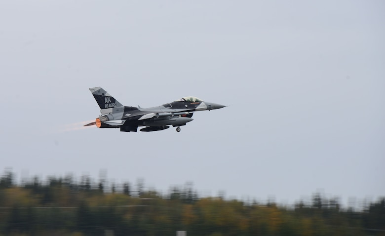 An F-16 Fighting Falcon, assigned to the 18th Aggressor Squadron, takes off in support of exercise Valiant Shield on Eielson Air Force Base, Alaska, Sept. 8, 2020. The mission of the 18th AGRS is to know, teach and replicate enemy tactics, techniques and procedures. Valiant Shield 20 provides an effective, flexible and capabilities centered force, enabling real-world proficiency in response to a variety of crises. (U.S. Air Force photo by Staff Sgt. Sean Martin)