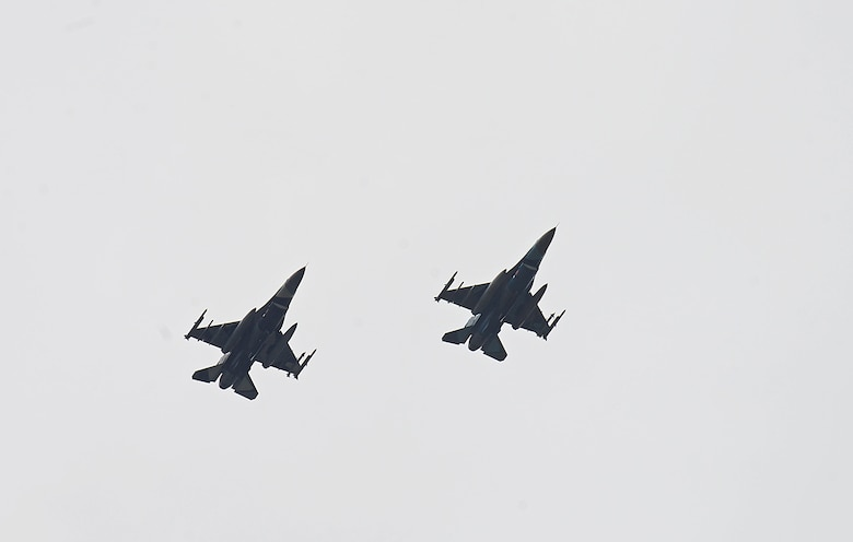 Two F-16 Fighting Falcons, assigned to the 18th Aggressor Squadron, fly over the Joint Pacific Alaska Range Complex (JPARC) on their way to support exercise Valiant Shield on Eielson Air Force Base, Alaska, Sept. 8, 2020. Valiant Shield 20 provides an effective, flexible and capabilities centered force, enabling real-world proficiency in response to a variety of crises. (U.S. Air Force photo by Staff Sgt. Sean Martin)