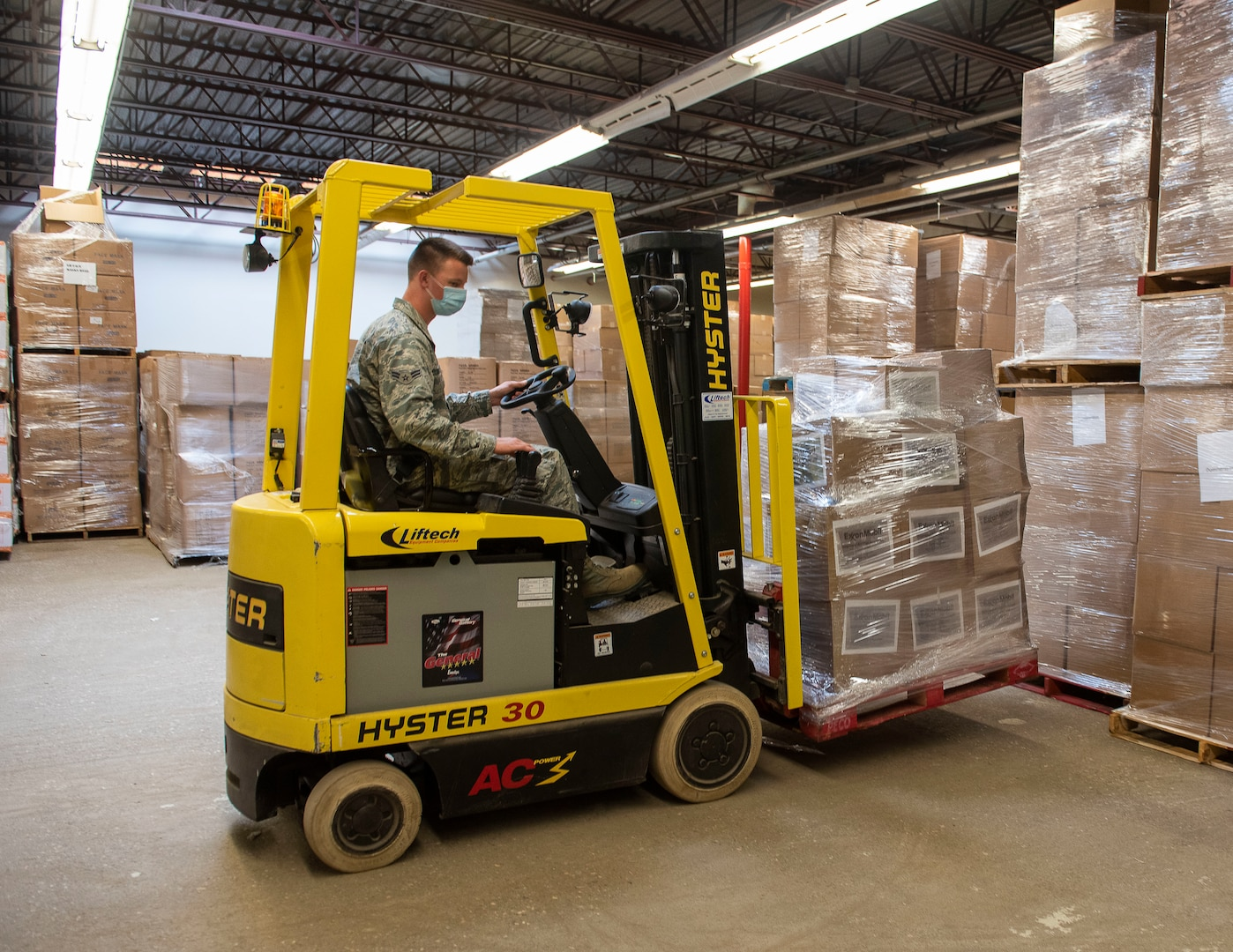 U.S. Air Force Airmen 1st Class Brett Woods from the 158th Fighter Wing, Vermont Air National Guard, maneuvers a forklift at the Strategic National Stockpile warehouse in Colchester, Vermont, August 27, 2020. The Defense Logistics Agency is working with the Federal Emergency Management Agency and the Department of Health and Human Services to replenish the nearly depleted SNS with personal protective equipment as the nation continues responding to COVID-19.